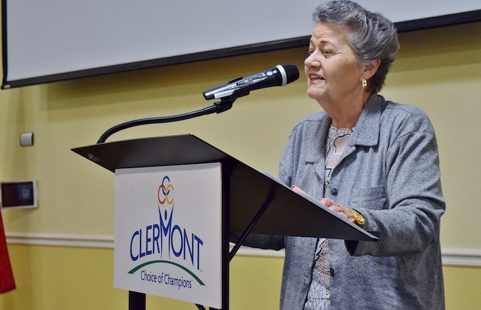 Clermont Mayor Gail Ash gives opening remarks at the podium.