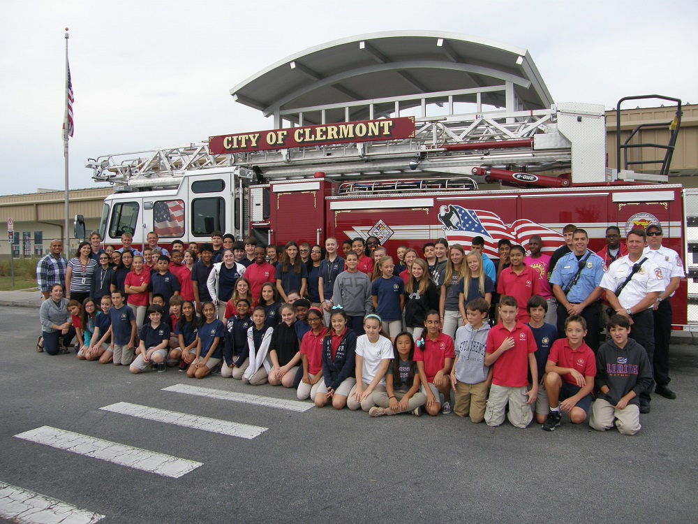 Kids and Fire Department in Front of Fire Truck